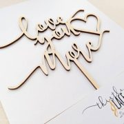 Love you more cake topper by Thistle and Lace Designs Inc.