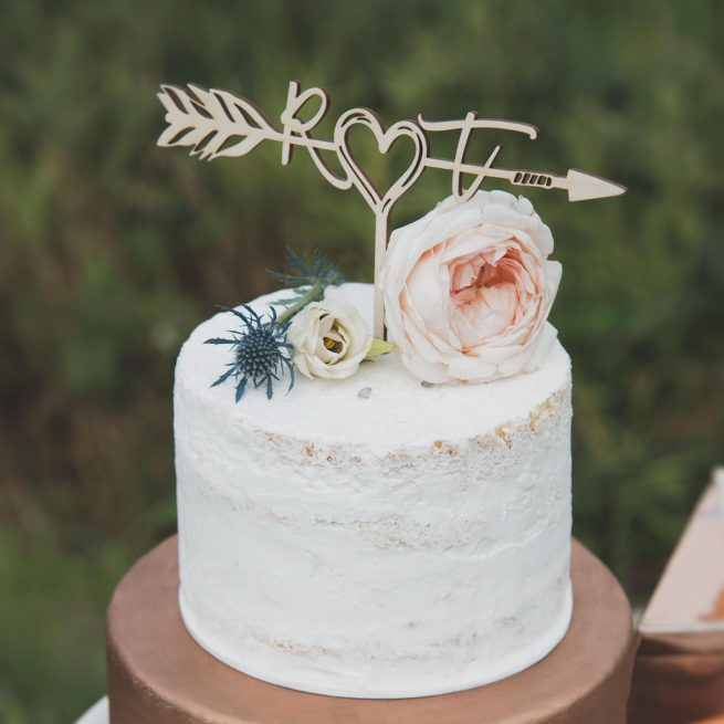 Initials in a boho arrow cake topper