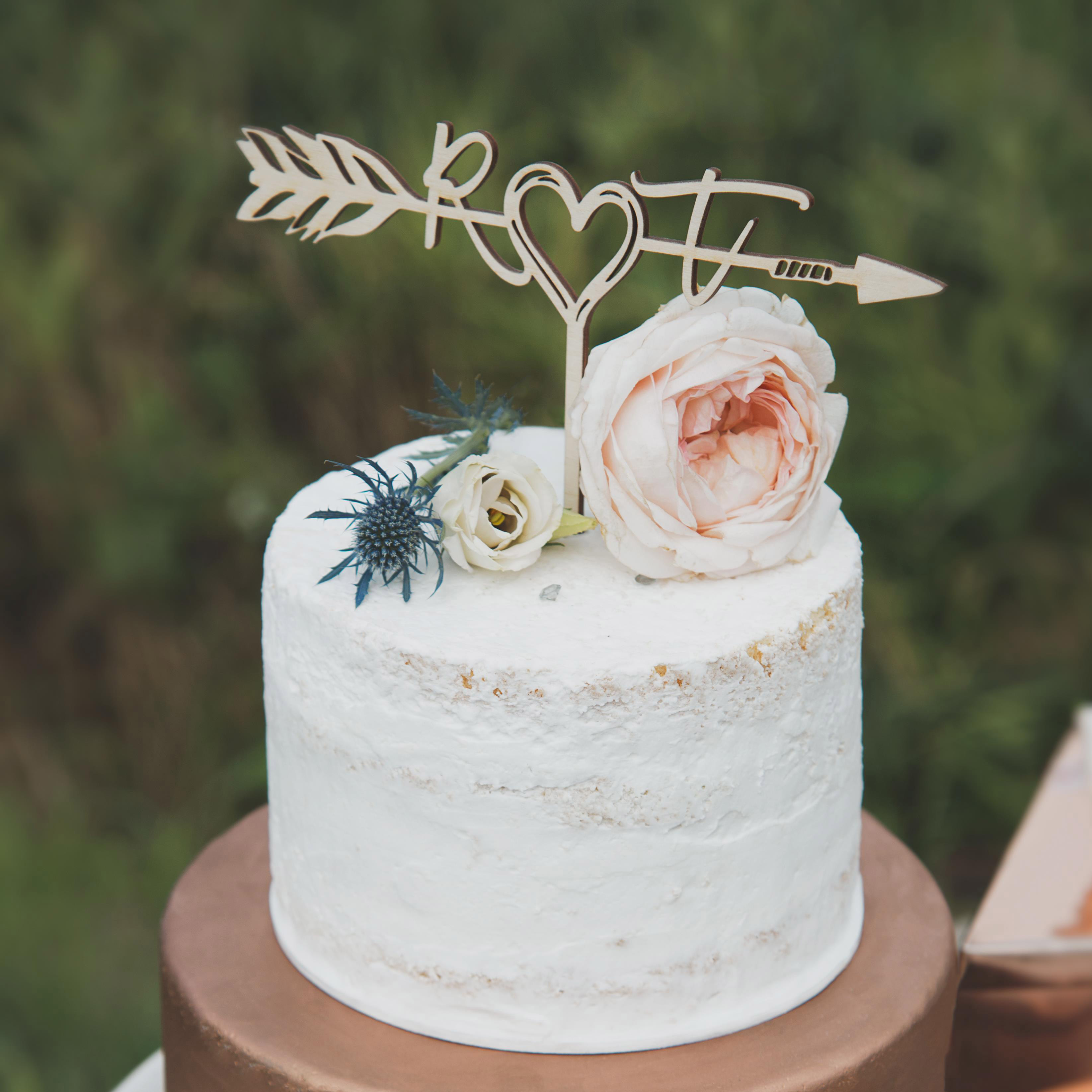 Initials in a boho arrow cake topper by Thistle and Lace