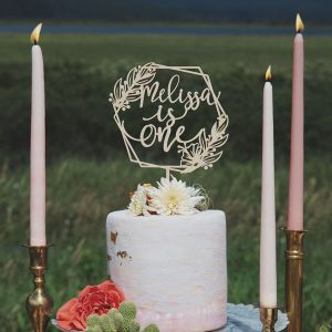 Custom birthday cake topper with hexagon and floral accents