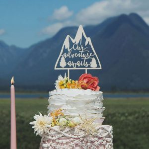 Our Adventure Awaits Adventure themed wedding cake topper