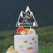 Years of Adventure anniversary cake topper